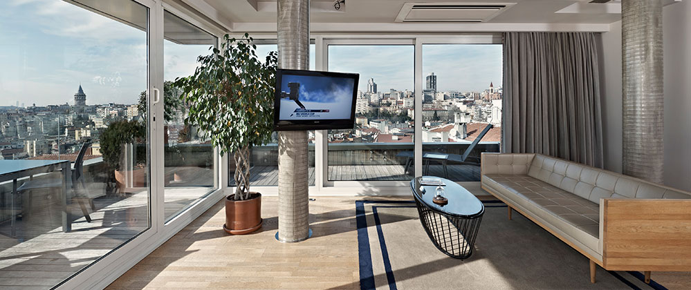 Living room and view of Penthouse at Witt Istanbul Hotel.